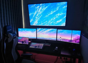 desktop gaming battlestation with multiple monitors